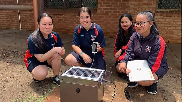 NXplorers students with their solar charging station at their school